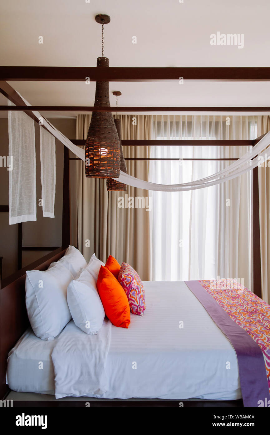 Aug 6 2014 Hua Hin Thailand Asian Thai Tropical Hotel Room With Wooden Four Poster Bed And Colourful Pillows Rattan Pedant Lamps Hanging From Cei Stock Photo Alamy