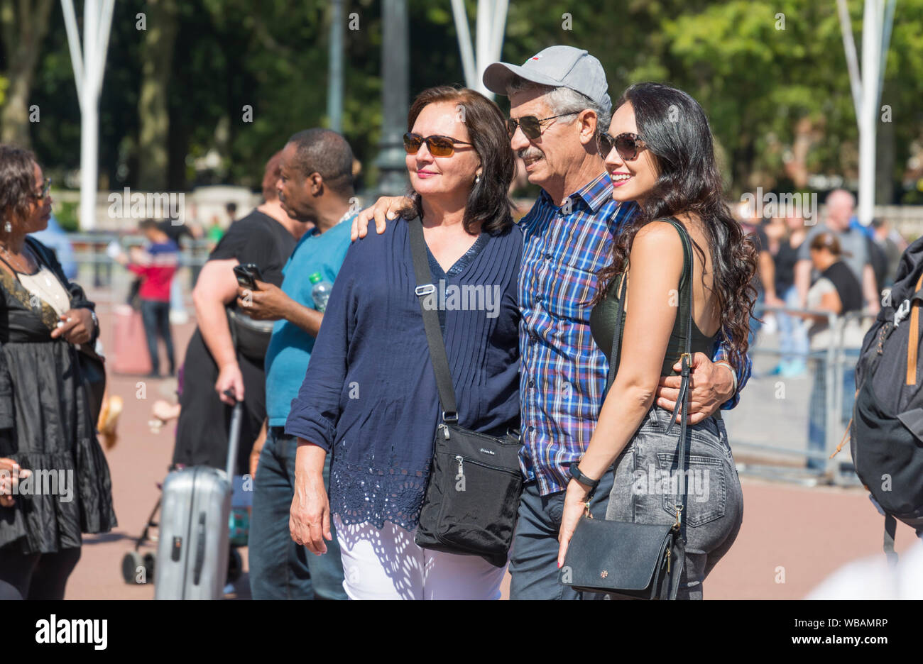Group of tourists posing for a photo in Summer in Central London, England, UK. Stock Photo