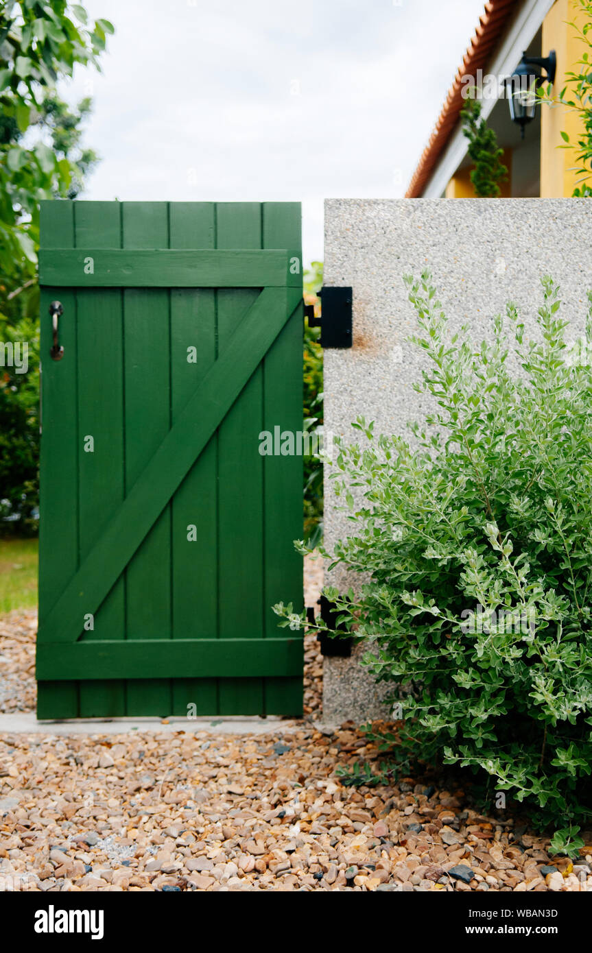 Garden green gate with plant shrub and stone ground. Small ... on decorative iron gates for homes, sliding window designs for homes, ceiling designs for homes, iron security gates for homes, new window designs for homes, window grill designs for homes, modern gate designs for homes, side gate designs for homes, portico designs for homes, wood gate designs for homes, lawn designs for homes, door designs for homes, bay window designs for homes, iron walkway gates, iron gates design in the philippines, steel gate designs for homes, media room designs for homes, wrought iron gate for homes, bathroom window designs for homes, gutter designs for homes,