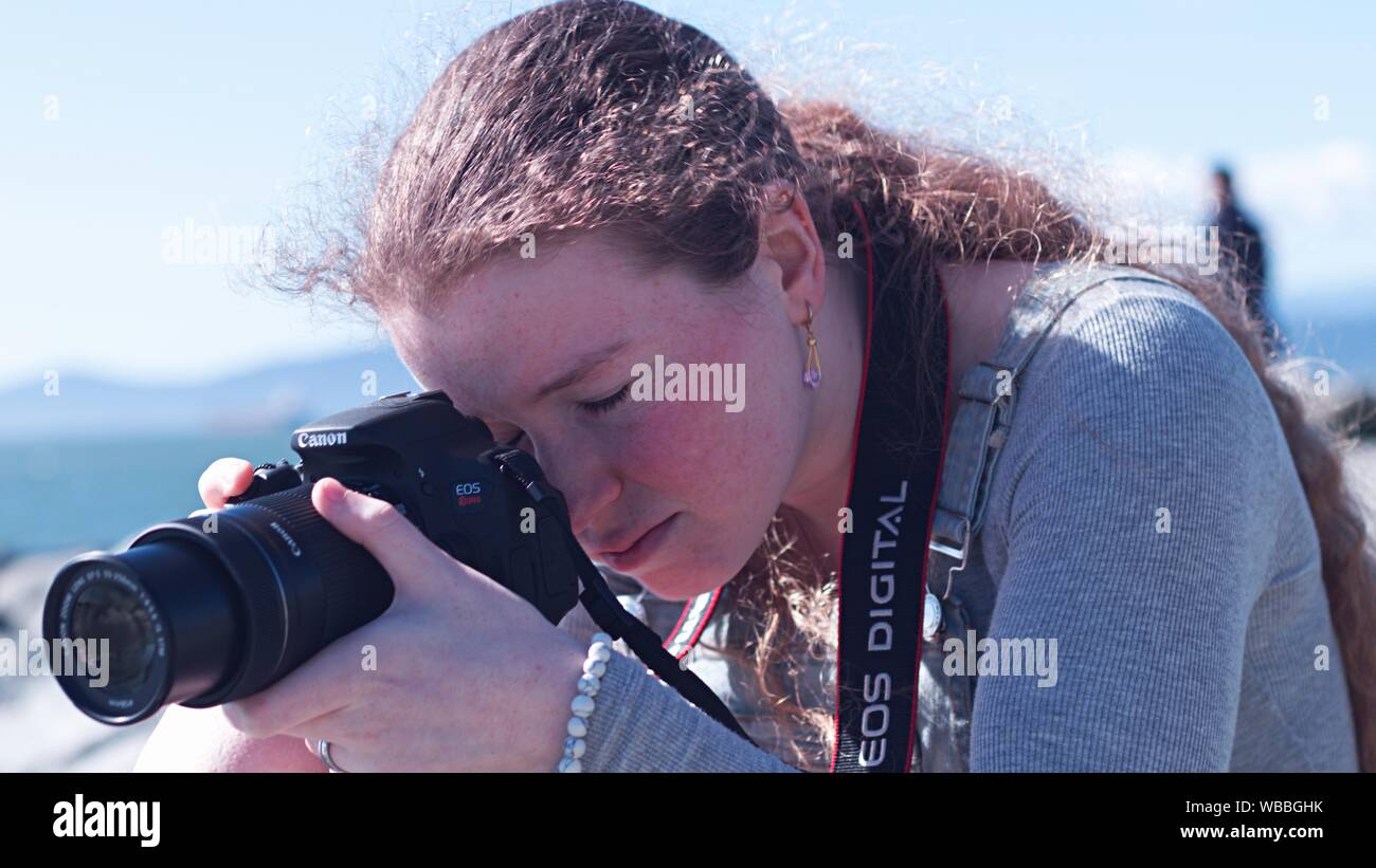 Young Canon EOS Rebel Stock Photo
