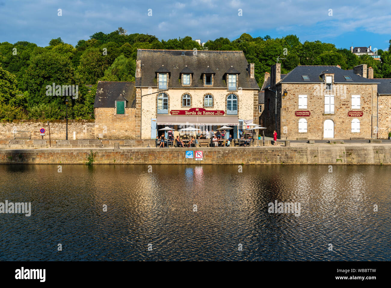 Dinan, France - July 23, 2018: View of a typical restaurant in the port of the town on the river Rance at sunset, French Brittany Stock Photo