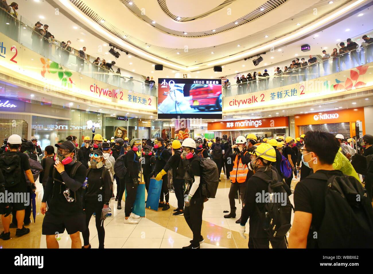 Hong Kong, China. 25th Aug, 2019. A peaceful rally turns violent with several clashes between protesters and police at Tsuen Wan. Protesters retreat back to the city mall when the police pushes forward to disperse the crowds Credit: Gonzales Photo/Alamy Live News Stock Photo