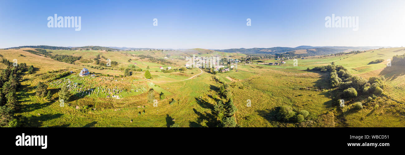 Panoramic landscape. Aerial drone view of Matkiv village in Carpathians, Ukraine. Stock Photo