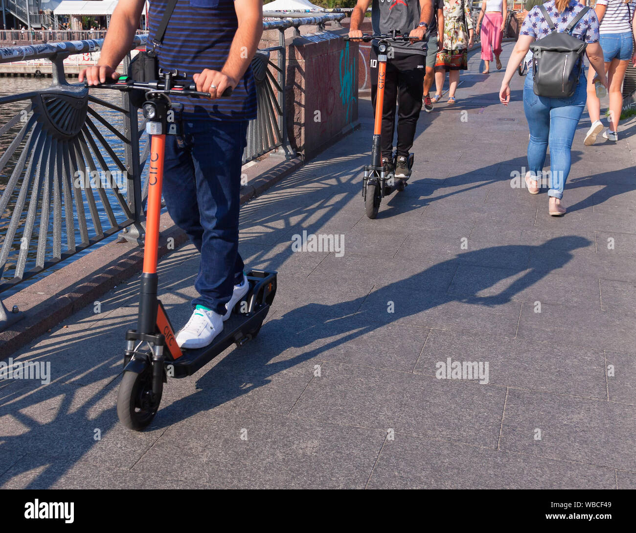 E-scooters between pedestrians in Berlin Stock Photo