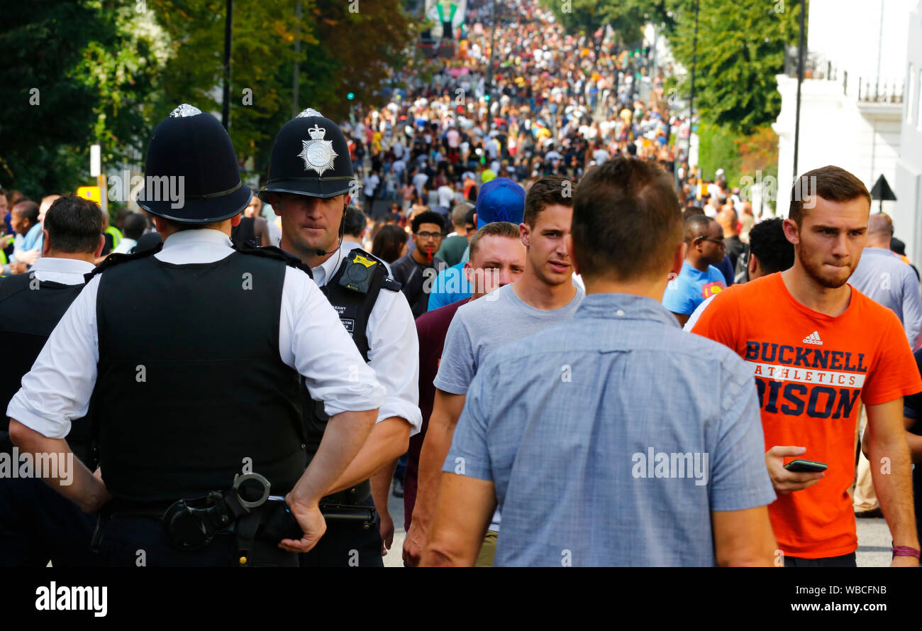 LONDON - AUG 28: Ladbroke Grove street with thousand of people at Notting Hill Carnival, largest in Europe, on Aug 28, 2017, London, UK. Carnival take Stock Photo