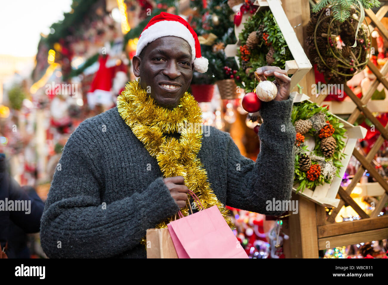 Christmas In Africa Traditions.Cheerful African American In Santa Hat Looking For New Year