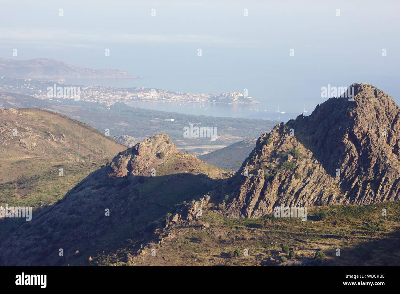 View back to Calvi and the Mediterranean, ascent to Bocca a U Saltu, near Calenzana, France, Corsica, GR20 Stock Photo