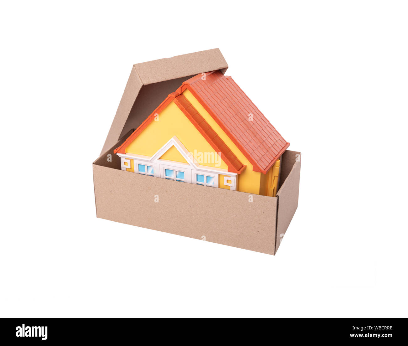 Toy Model Of A House In A Cardboard Box On White Background