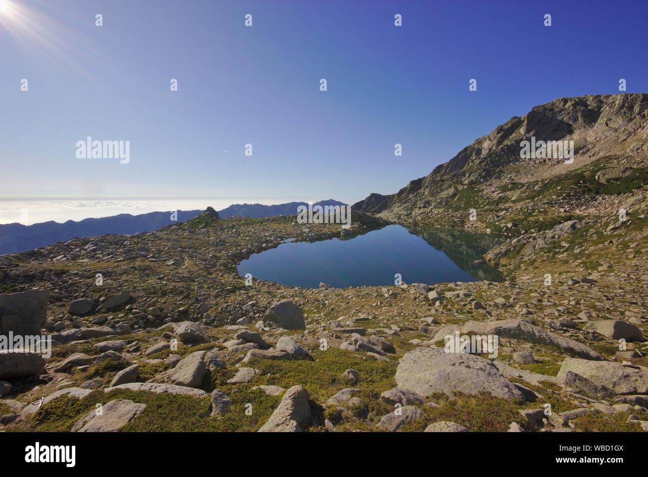 Lac de Bastiani and Monte Renoso, France, Corsica, GR20 Stock Photo
