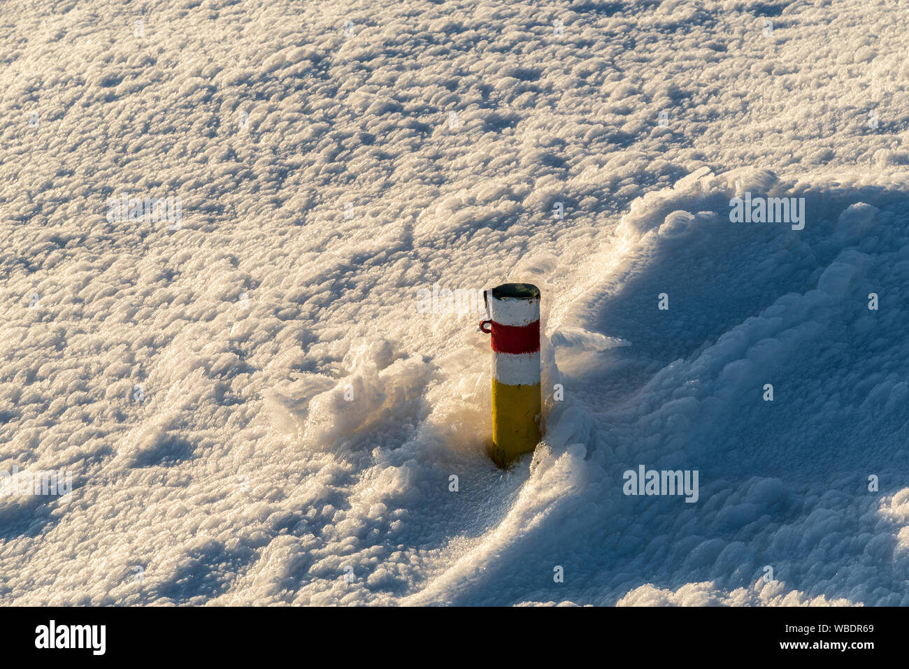 red marked hiking trail cairn with snow around in winter Martinske hole in Mala Fatra mountains in Slovakia Stock Photo