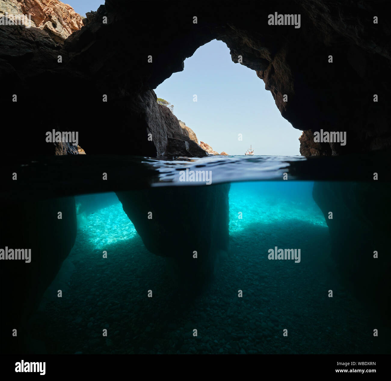 Over and under water inside a cave with several openings on the sea shore, Spain, Mediterranean, Costa Brava, Catalonia, Calella de Palafrugell Stock Photo