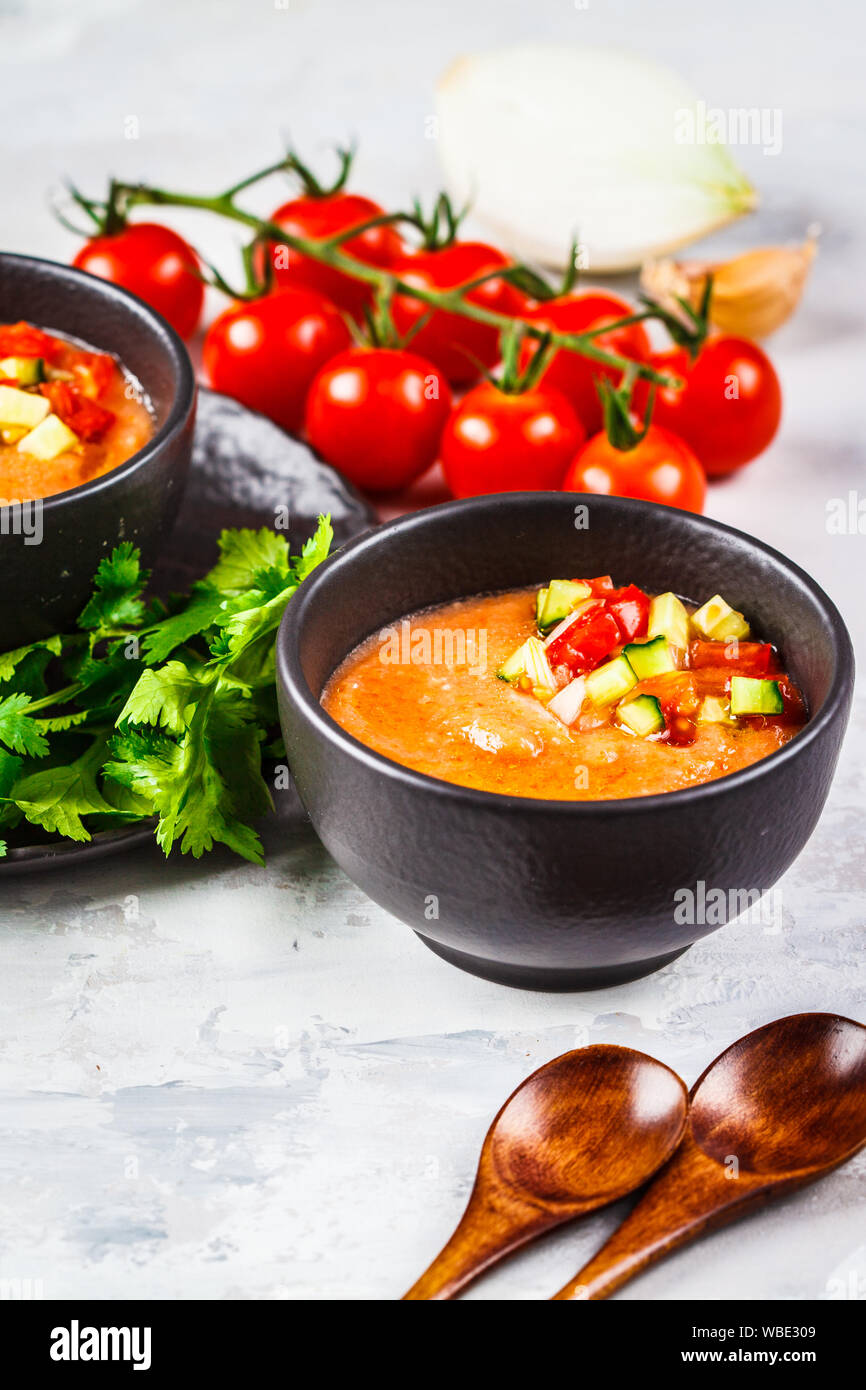 Traditional Cold Gazpacho Tomato Soup In A Black Bowl On A Gray