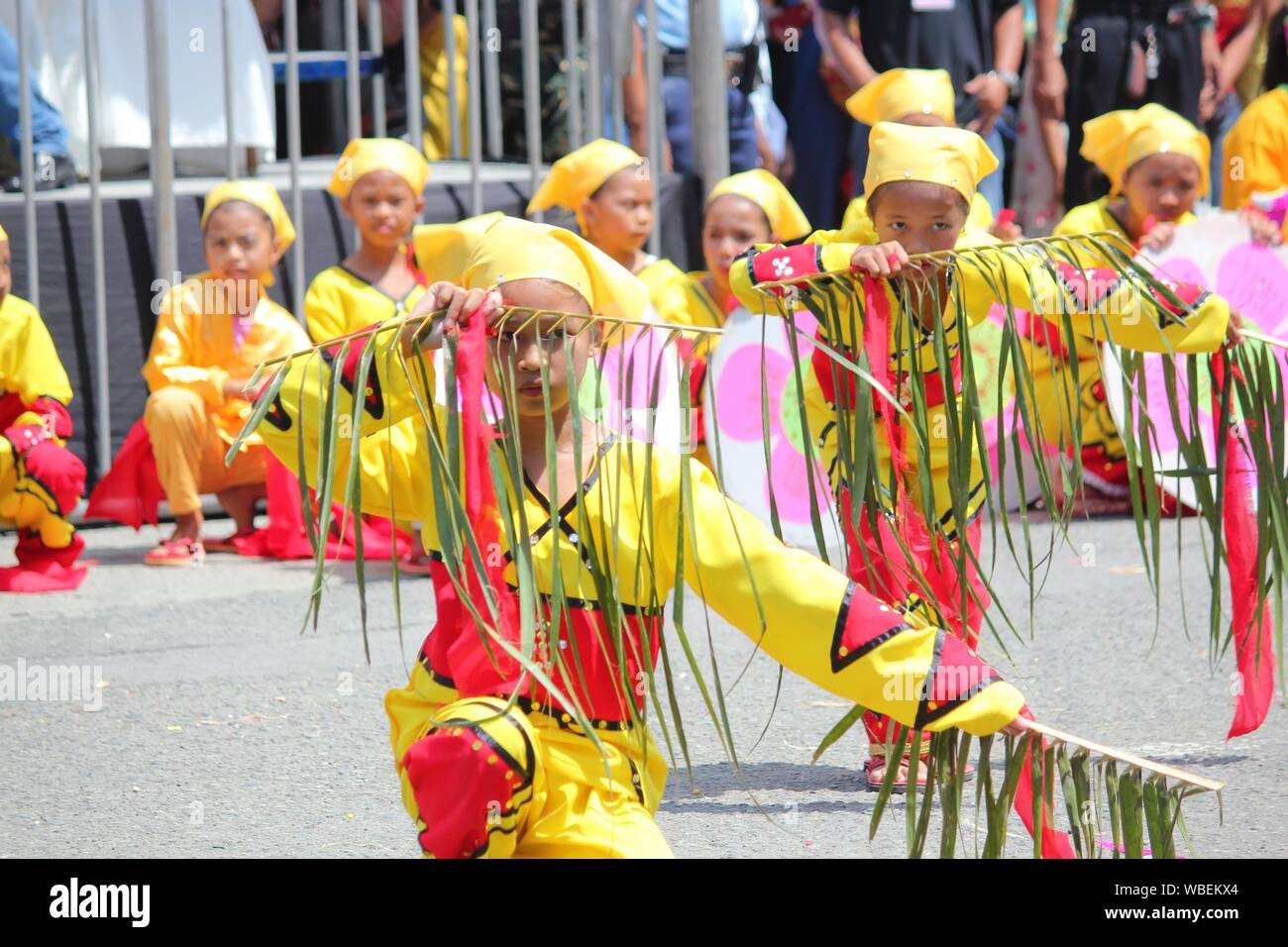 Davao City, Philippines-August 2014: Street dancers perform using coconut fronds. Kadayawan is celebrated August each year to give thanks for life and Stock Photo