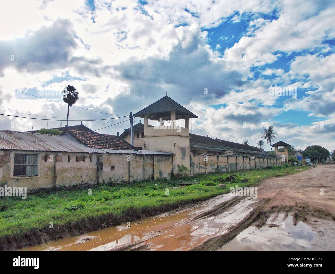 Old Prison Against Cloudy Sky Stock Photo