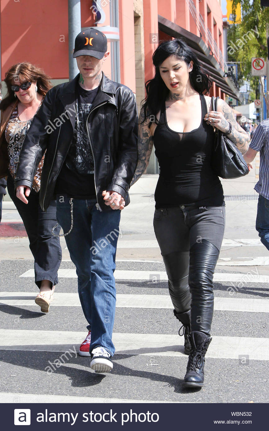 "West Hollywood, CA - Lovebirds Kat Von D and Deadmau5 matched their dark colors as we spotted the couple arriving at Hugo's restaurant for lunch. Electronic music star Deadmau5 popped the question last December, using his Twitter account: ""I can't wait for Christmas so ... Katherine Von Drachenberg, will you marry me?"", he also included a photo of a diamond ring with the disclaimer, ""Changing the diamond to black diamond FYI. Sorry for the jpg … they'll finish the actual ring soon I hope."" AKM-GSI March 3, 2013, Stock Photo"
