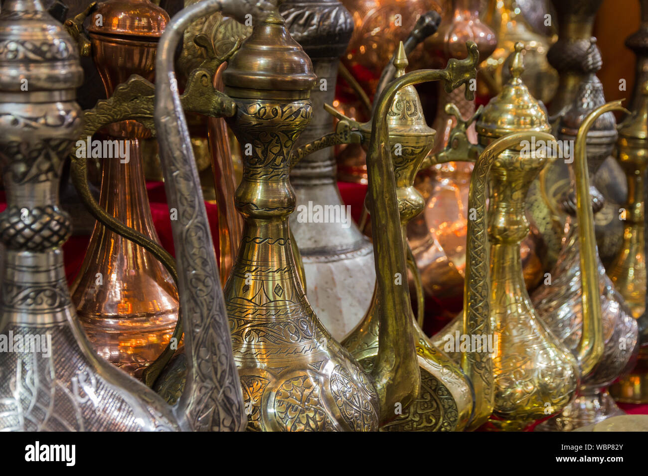 Decorative old style metal pitchers for sale; Istanbul, Turkey. Stock Photo