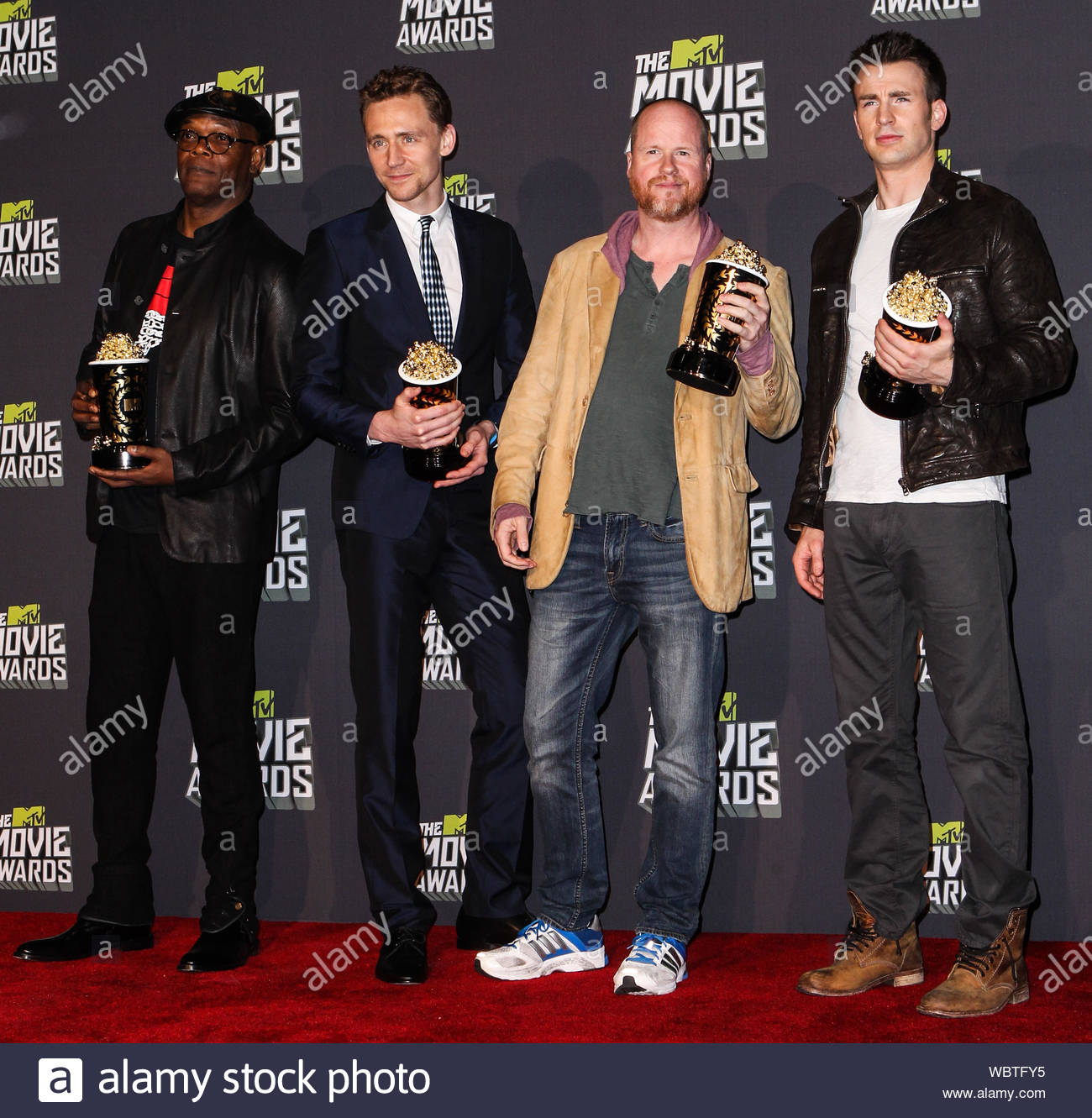 "Culver City, CA - Samuel L. Jackson and Tom Hiddleston, director Joss Whedon, and actor Chris Evans, winners of Movie of the Year for ""Marvel's The Avengers,"" poses in the press room during the 2013 MTV Movie Awards held at Sony Pictures Studios. AKM-GSI, April 14, 2013 Stock Photo"