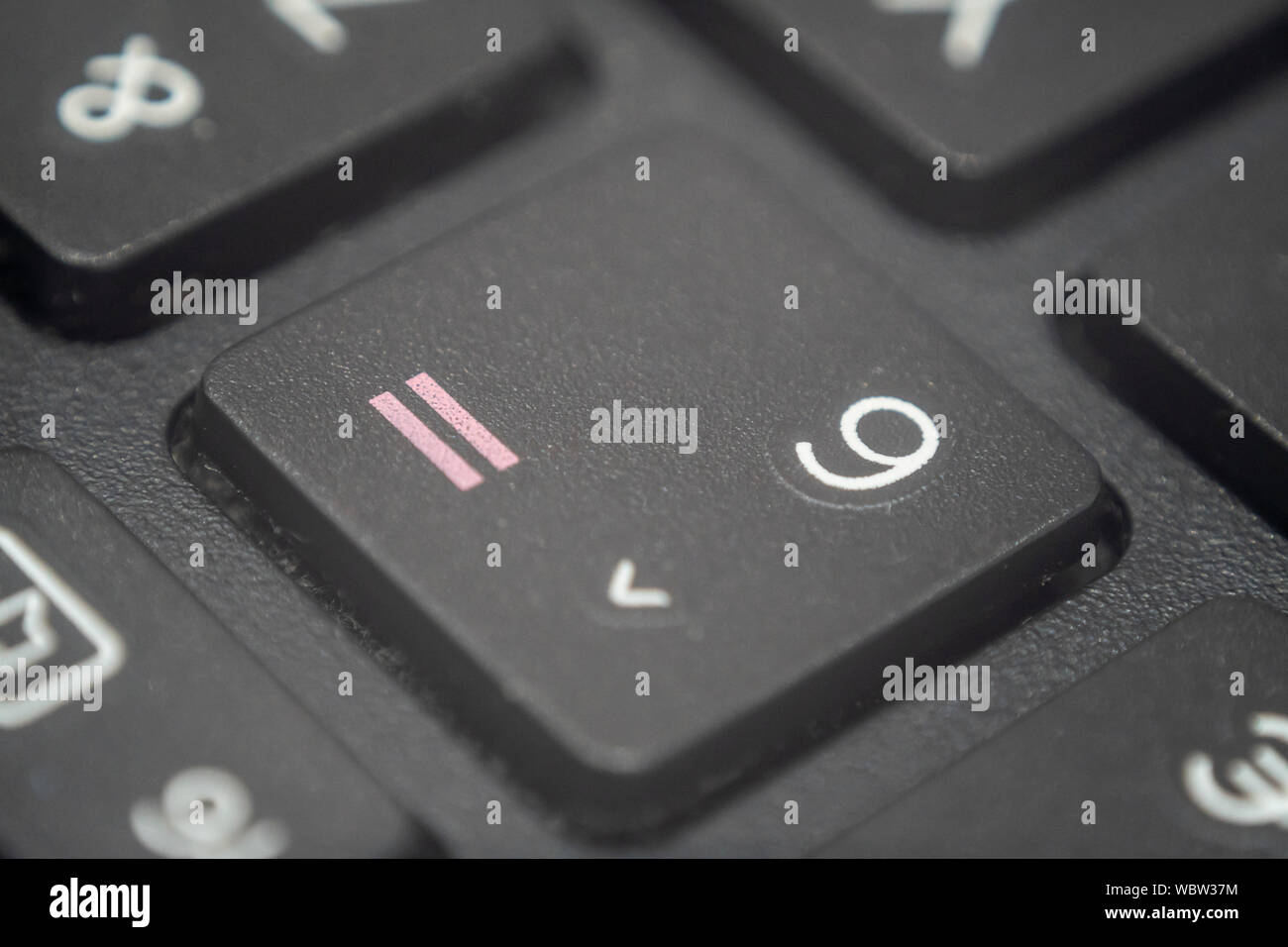 Extreme macro of the number six and equals sign key on a laptop keyboard Stock Photo