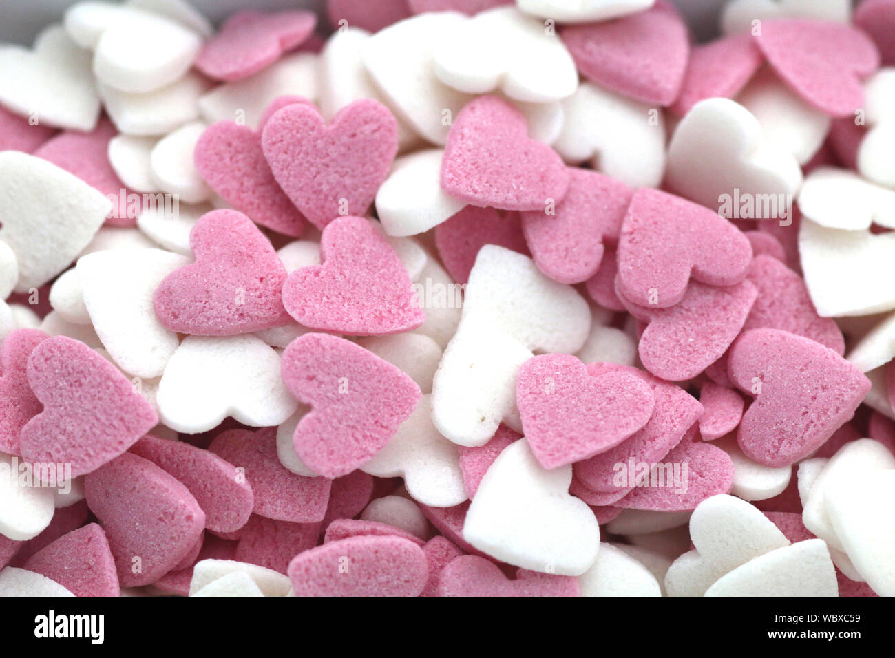 Full Frame Shot Of Heart Shaped Sweet Candies Stock Photo