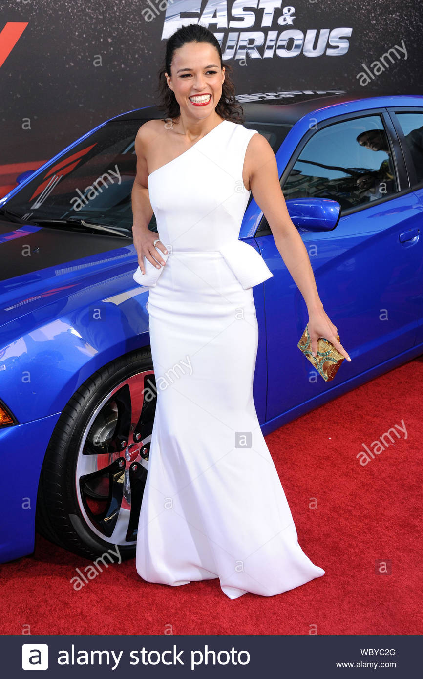 """Universal City, CA - Michelle Rodriguez arrives at the premiere of """"Fast & Furious 6"""" in Universal City. AKM-GSI, May 21, 2013 Stock Photo"""