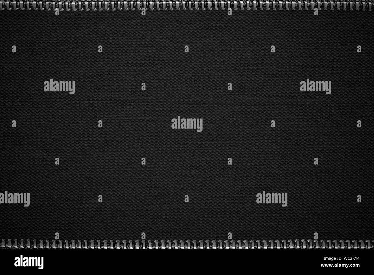 black abstract background or cloth grid pattern texture with silver zips Stock Photo