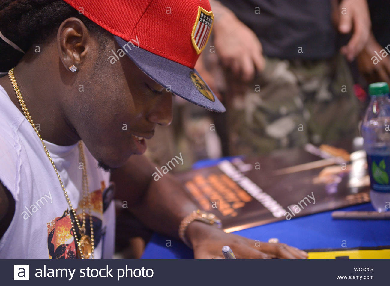 miami fl rapper ace hood signs copies of his new cd trials tribulations at best buy pembroke pines akm gsi july 19 2013 stock photo alamy alamy