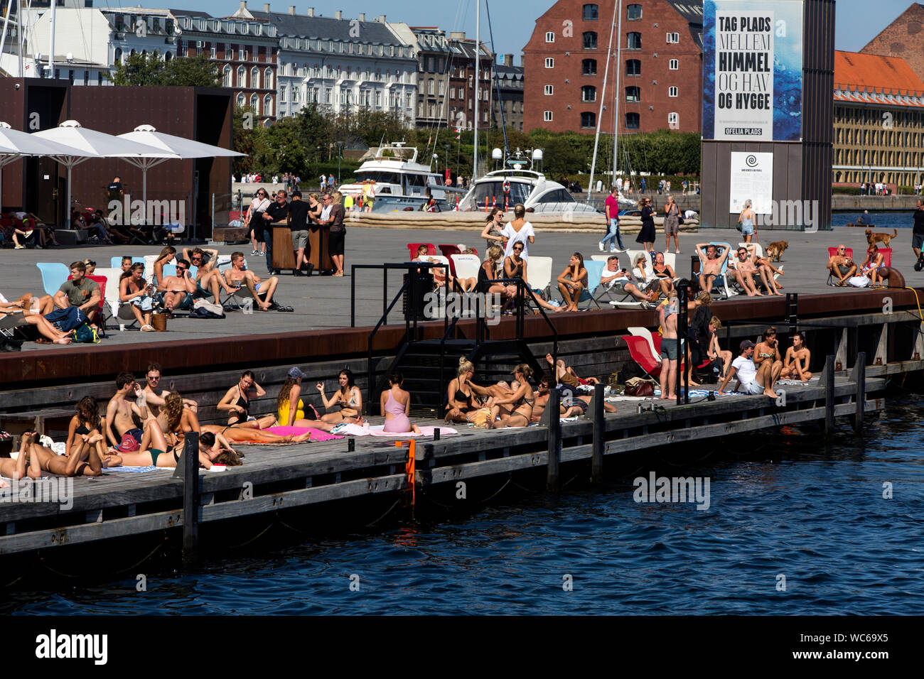Copenhagener and tourists at the wooden pier at Ofelia