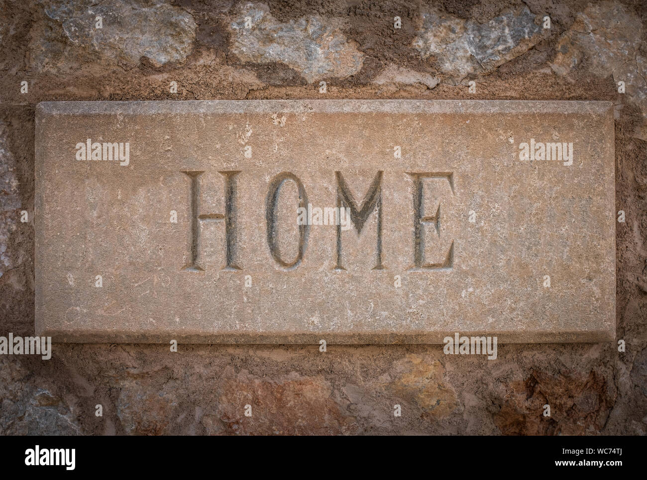The Word Home Carved In Stone Outside A Villa In Spain Stock Photo