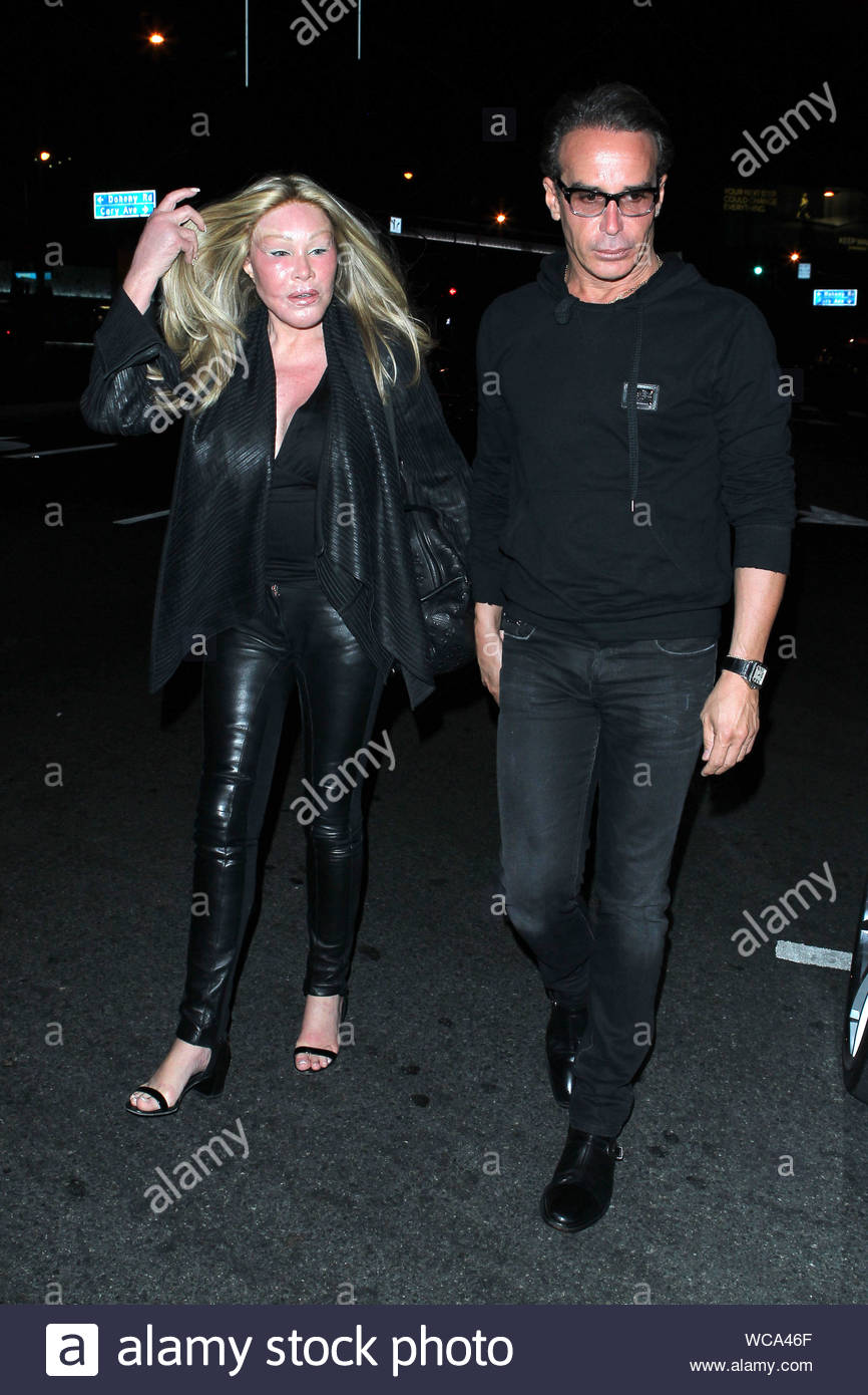 """West Hollywood, CA - Jocelyn Wildenstein and her boyfriend, fashion designer Lloyd Klein depart a dinner date at BOA Steakhouse in West Hollywood Sunday night. The 73-year-old socialite is often called, """"Cat Woman"""" in reference to the extreme plastic surgeries that she has undergone over the years. AKM-GSI, September 29, 2013 Stock Photo"""