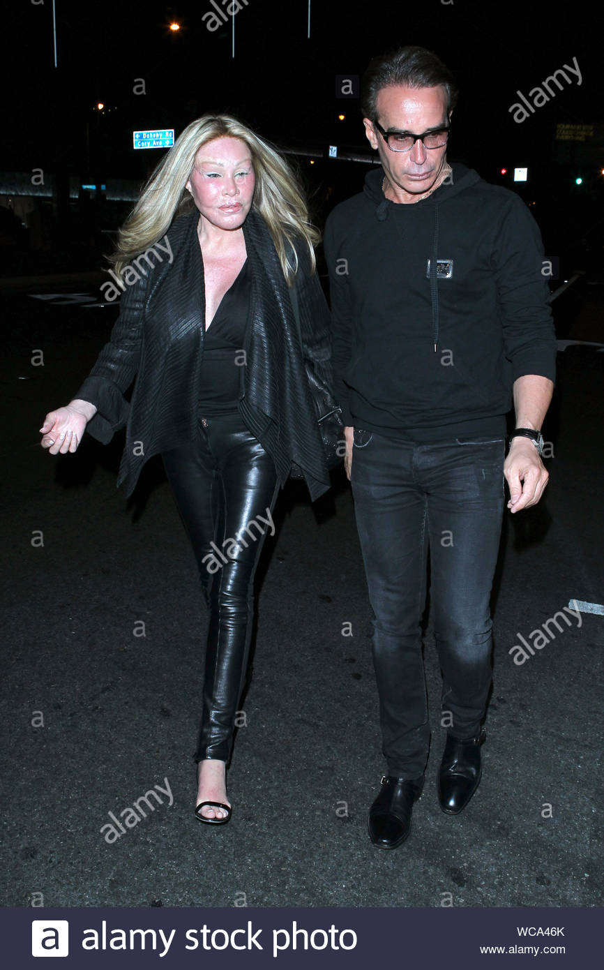 "West Hollywood, CA - Jocelyn Wildenstein and her boyfriend, fashion designer Lloyd Klein depart a dinner date at BOA Steakhouse in West Hollywood Sunday night. The 73-year-old socialite is often called, ""Cat Woman"" in reference to the extreme plastic surgeries that she has undergone over the years. AKM-GSI, September 29, 2013 Stock Photo"