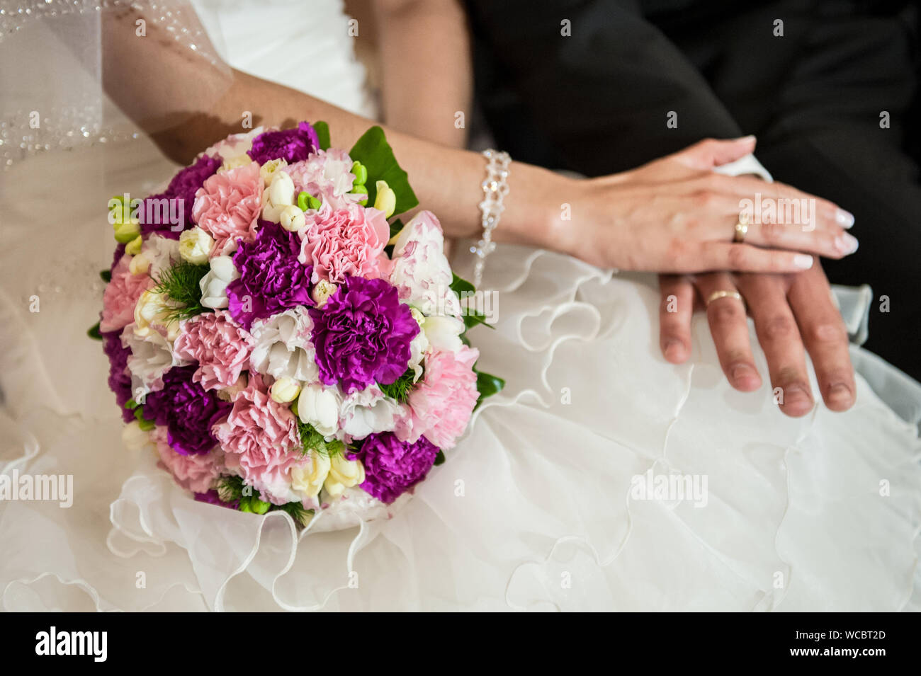 Midsection Of Couple During Wedding - Stock Photo