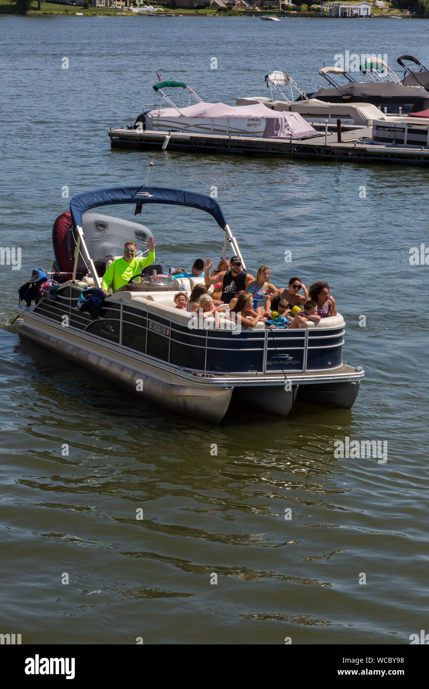 A Bennington Pontoon Full Of Young People Moves Through The