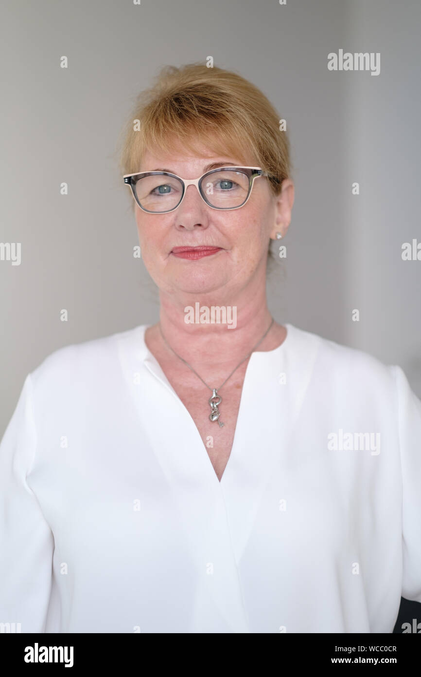 Hanover, Germany. 22nd Aug, 2019. Cathrin Burs, the new President of the Chamber of Pharmacists of Lower Saxony, after an interview. In Lower Saxony, the number of pharmacies has fallen by more than 10 percent since 2009 to currently 1892. When rural doctors' practices close, local pharmacists often do not find a successor either. The new president of the Chamber of Pharmacists of Lower Saxony, Cathrin Burs, hopes for impulses from the Pharmacy Strengthening Act planned at federal level. Credit: Ole Spata/dpa/Alamy Live News Stock Photo