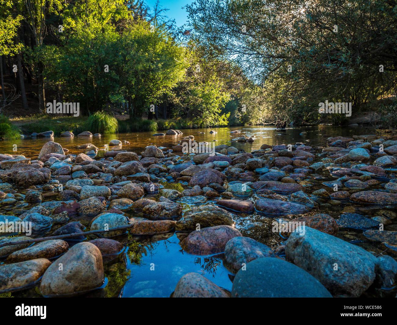 The River Manzanares. Along its course through La Pedriza, in Guadarrama Mountains National Park, Madrid, Spain. Stock Photo