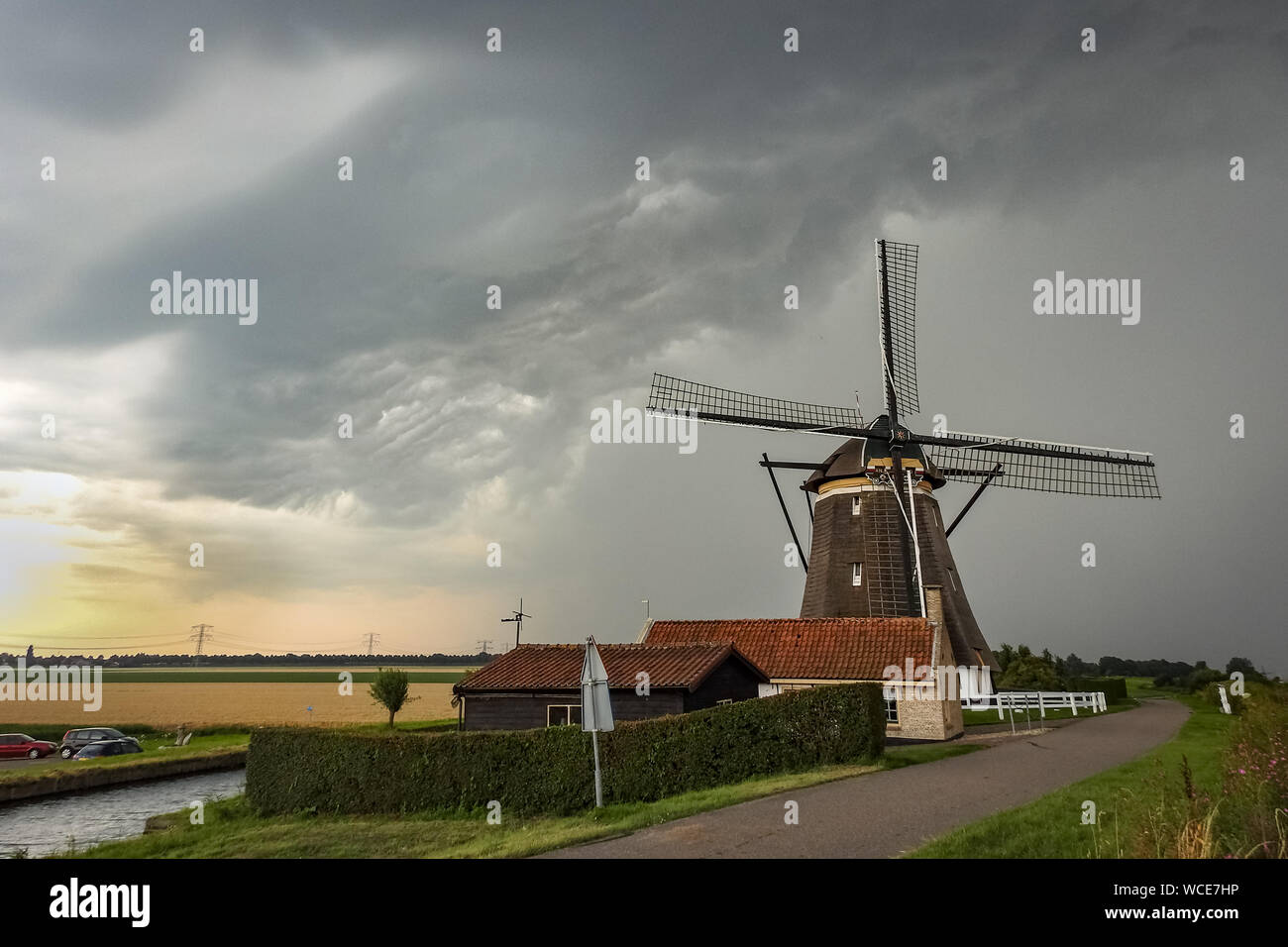 Dutch windmill with an approaching thunderstorm Stock Photo