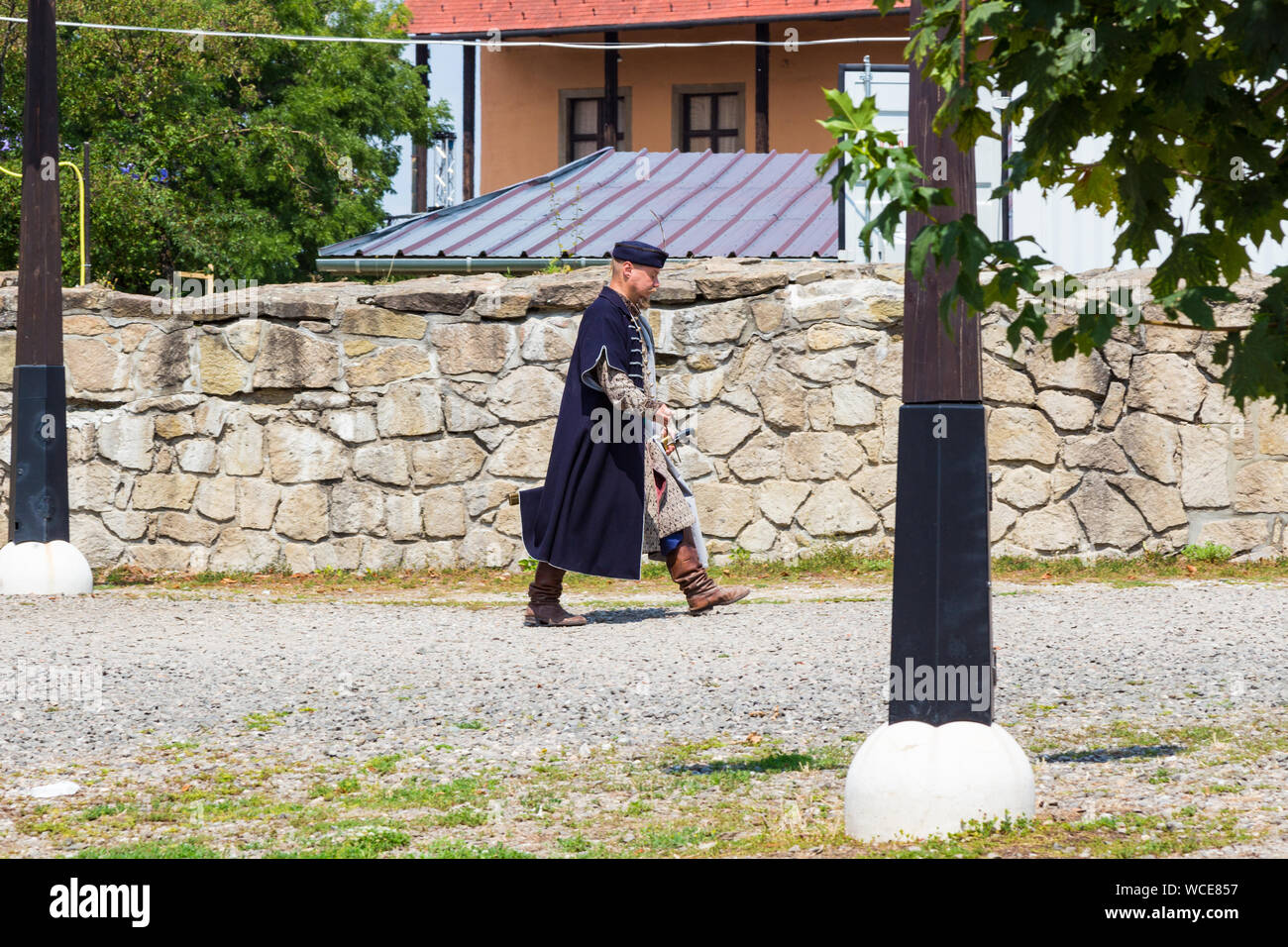 Man walking in traditional 16th century Hungarian costume in the Castle of Eger, Hungary Stock Photo