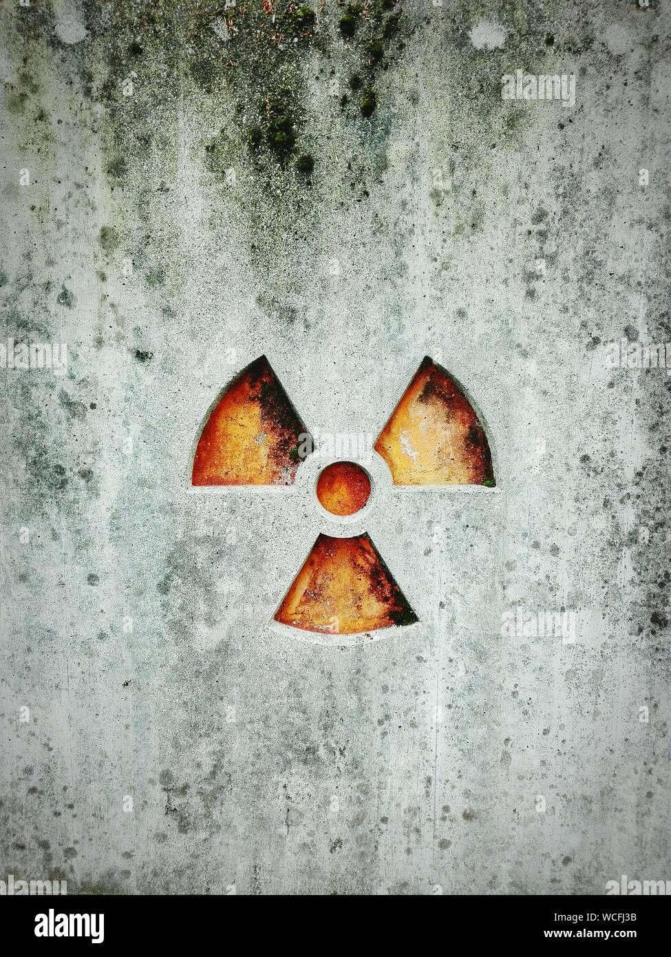 Radioactive Warning Symbol On Wall Stock Photo