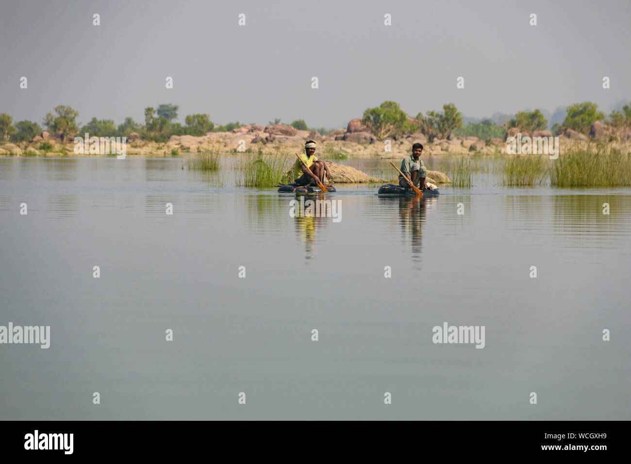 Local fishermen floating on makeshift rafts on the Ken River, Panna National park, Madhya Pradesh, India, Central Asia Stock Photo