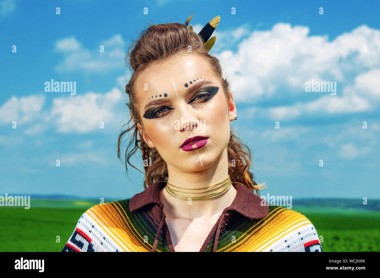 Portrait Of A Girl With Makeup Amazon Viking Aggressive War Paint Dressed In A Poncho On The Background Sky Stock Photo Alamy
