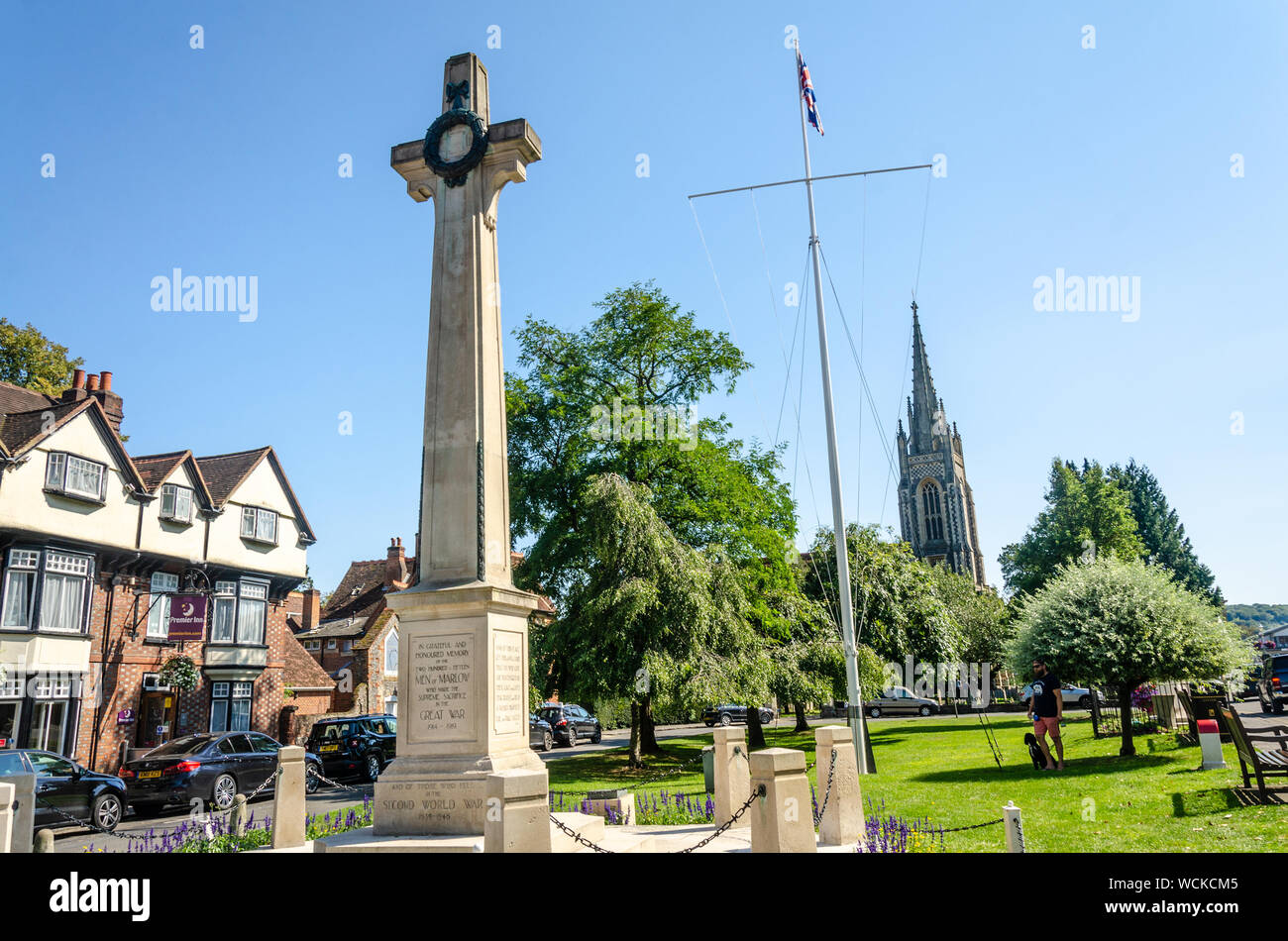 A war memorial in the form of a large stone cross at the bottom end of The High Street in Marlow, Buckinghamshire, UK Stock Photo