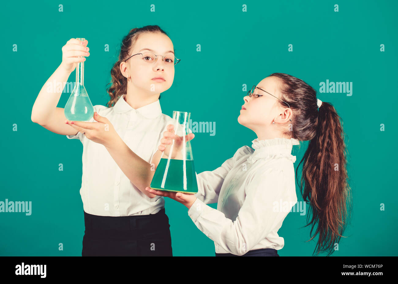 children study chemistry lab. back to school. biology education. little smart girls with testing flask. school kid scientist studying science. Bright minds at work. laboratory work. school work place. Stock Photo