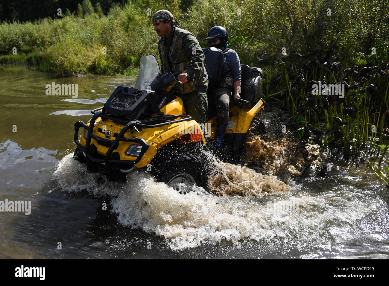 ALTAI TERRITORY, RUSSIA - AUGUST 28, 2019: Forest ranger Alexei Rovkovsky (L) rides an all-terrain vehicle in a protected area of taiga managed by KBU Altaipriroda in Togul District of Russia's Altai Territory, which is to become part of a protected area under the working name of Togul National Park; according to the Russian government's project Ekologia (Ecology), the proposed national park is to be established by 2024 and to include parts of Zarinsk District, Togul District, and Yeltsovka District of the Altai Territory, with a total area of over 160 hectares. Kirill Kukhmar/TASS Stock Photo