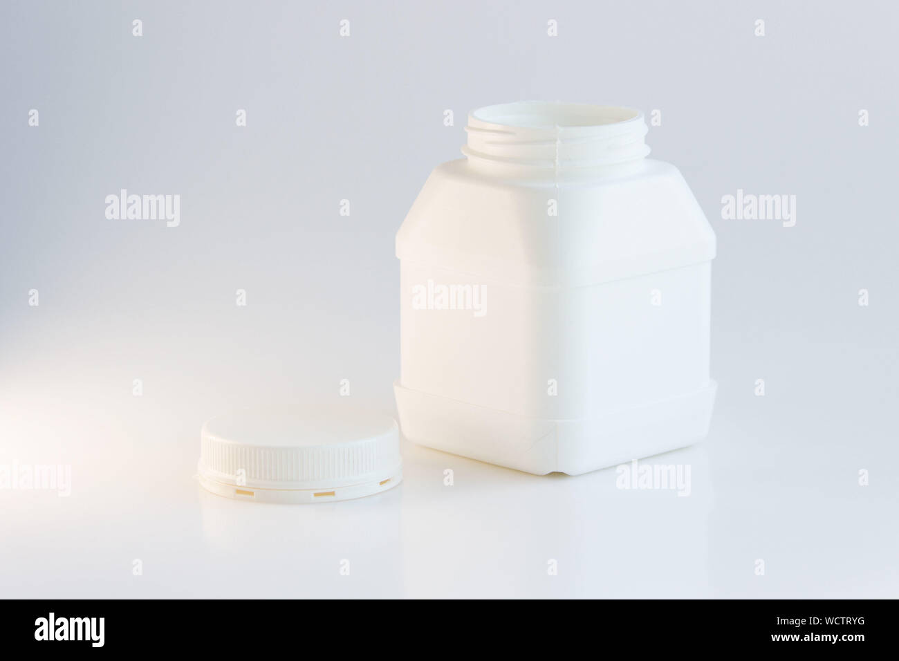white plastic jar with lid on a white background. Stock Photo