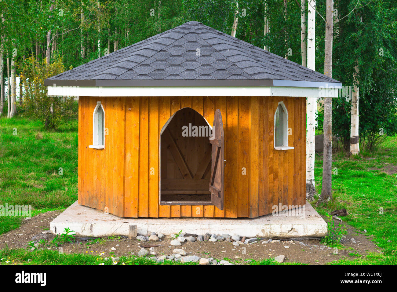 A Small Wooden House For Animals The Roof Of The House Is Black