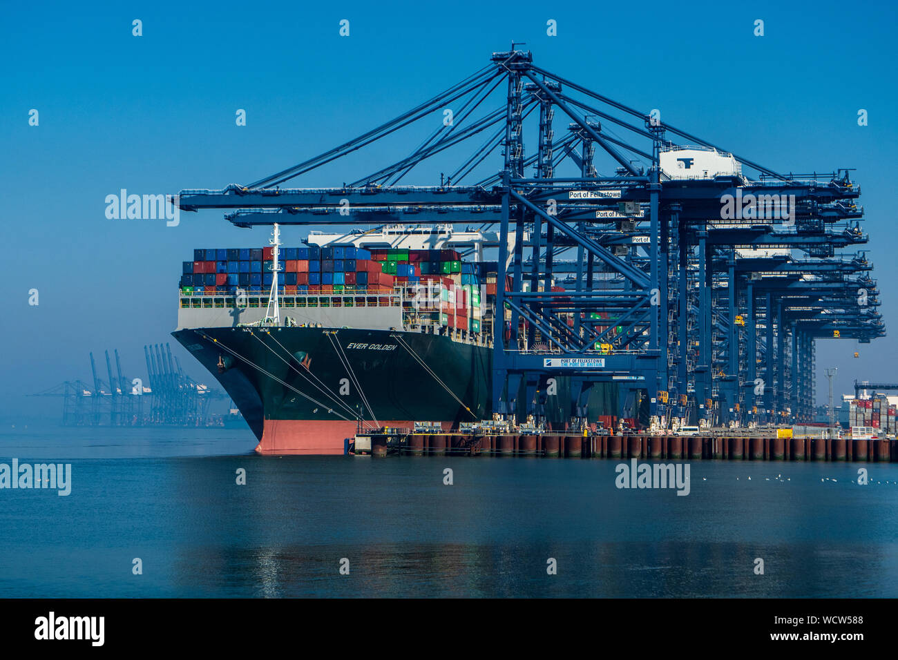 Global Britain - UK Trade at Felixstowe Container Port - The Ever Golden Container Ship unloads cargo at the Port of Felixstowe  UK Stock Photo