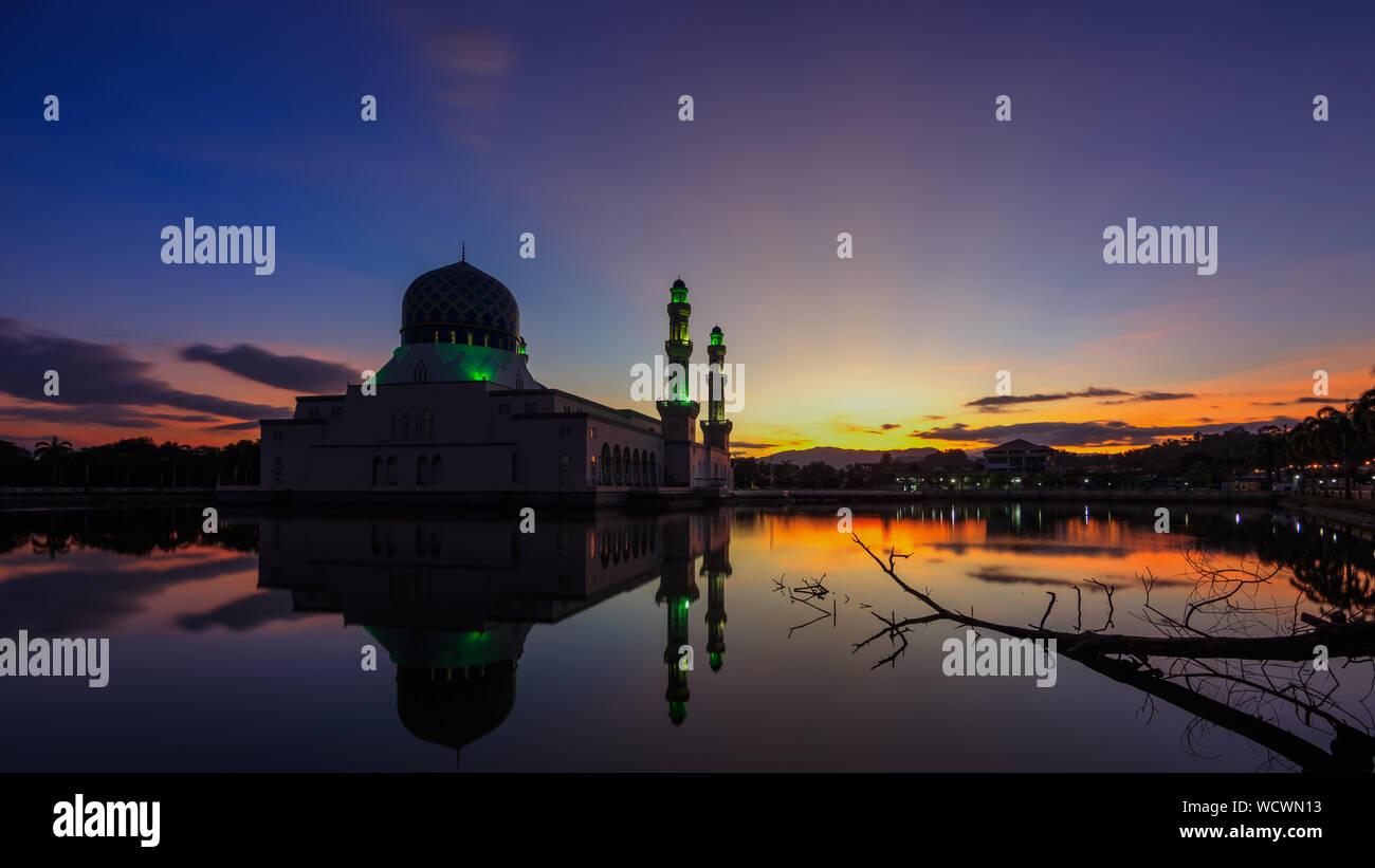 Kota Kinabalu City Mosquewith Reflection On Lake At Sunset Stock Photo