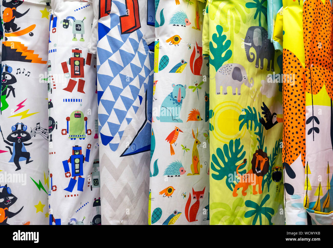 Blankets With Colored Duvet Covers In A Shop Window Stock Photo Alamy