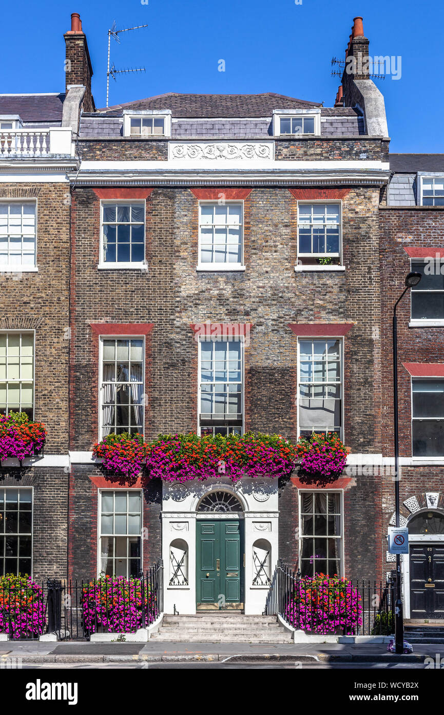 A Georgian terraced house decorated with natural flowers, Gower Street, Bloomsbury, Central London WC1, England, UK. Stock Photo