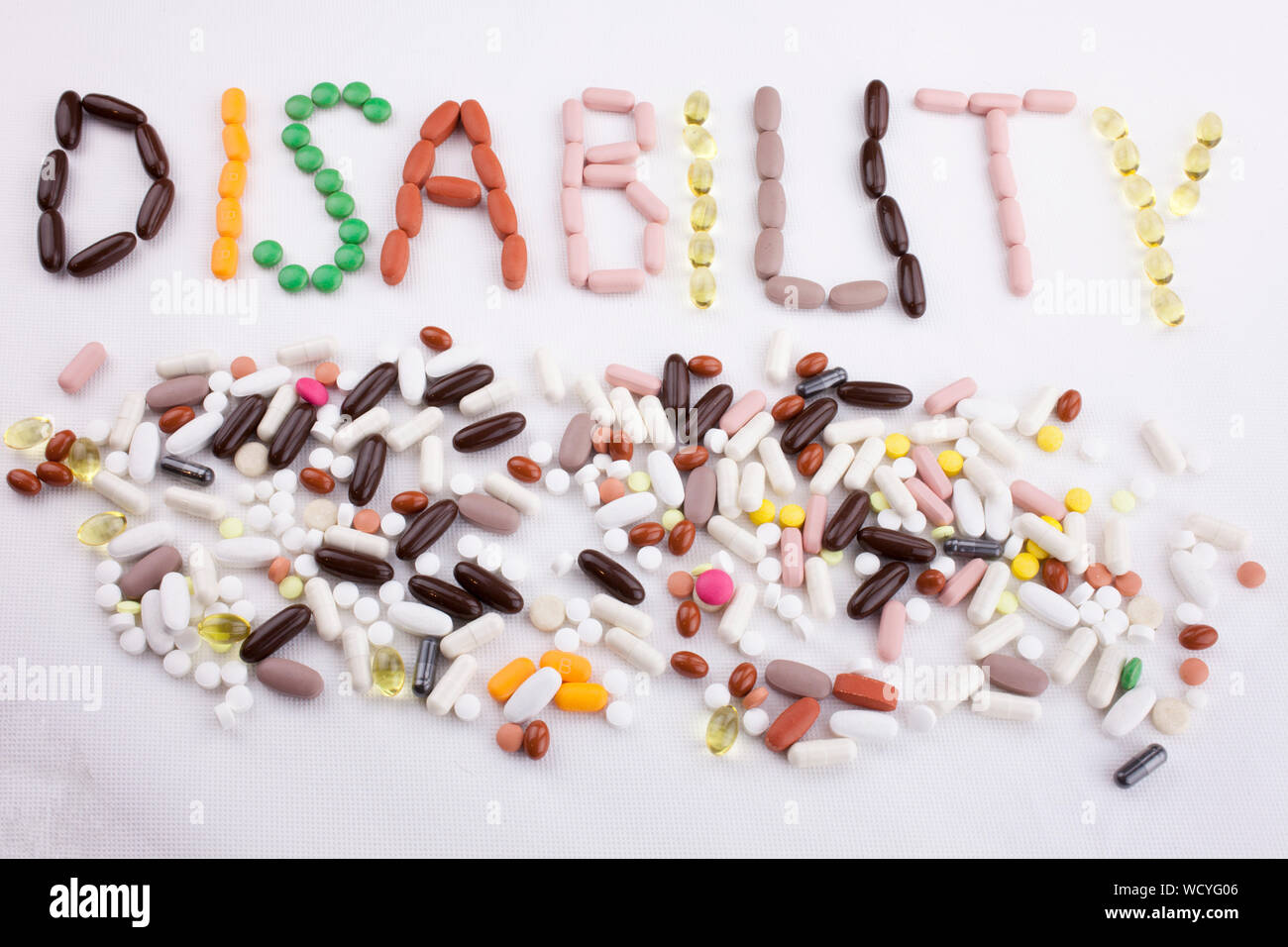 High Angle View Of Text Made With Pills On White Background Stock Photo