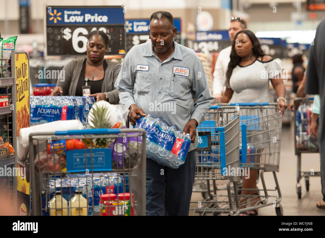 Fort Lauderdale, Florida, USA. 28th Aug, 2019. Residents of Florida stock up with groceries and water in preperation for hurricane Dorian, in Fort Lauderdale, Fla. Florida Governor, Ron Desantis, declared a state of emergency for 26 counties in Florida, as Hurricane is forecast to hit Florida as a major category 3 hurricane Credit: Orit Ben-Ezzer/ZUMA Wire/Alamy Live News Stock Photo